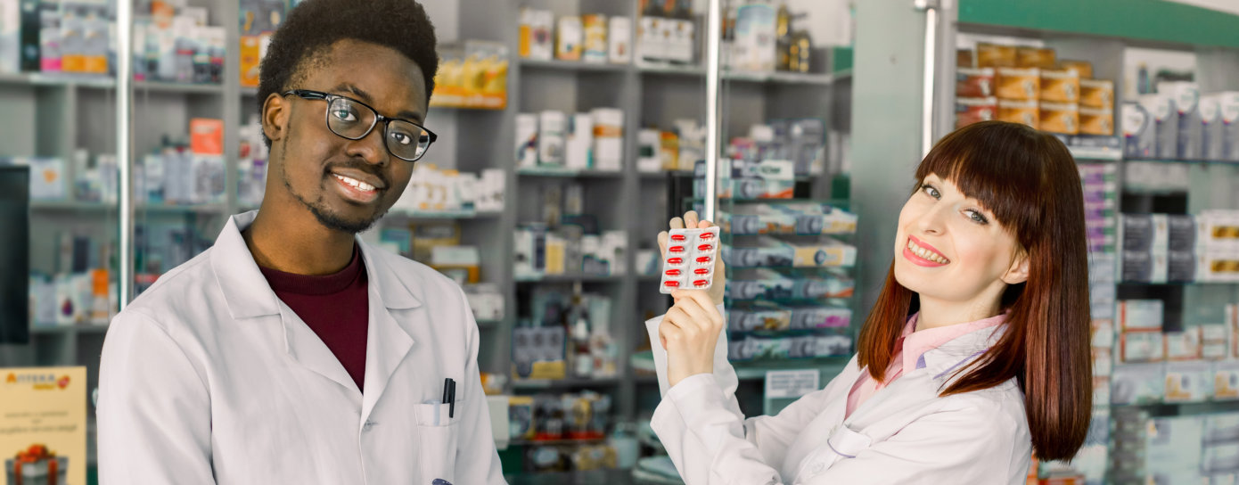 smiling female and male pharmacist
